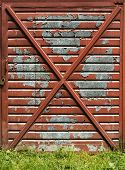pic of gash  - Paint is falling down on a old garage door - JPG