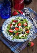 stock photo of pine nut  - Fresh delicious arugula strawberry blueberry pine nuts and blue cheese salad - JPG