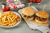 pic of sandwich  - Tasty sandwiches and french fries on plate - JPG