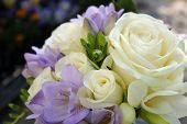 picture of purple rose  - A wedding bouquet of purple and cream roses and flowers - JPG