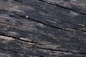 image of woodgrain  - Closeup of red cedar plank showing knot texture and natural woodgrain pattern as wood background - JPG