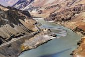 stock photo of jammu kashmir  - Indus river flowing through rocks of Ladakh Jammu and Kashmir Ladakh India - JPG