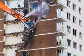 foto of deprivation  - Construction work demolishing high rise flats signifying housing and regeneration - JPG