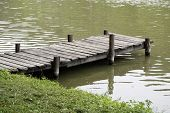 picture of jetties  - Very old wooden jetty at a peaceful fishing lake side - JPG