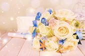 image of wedding table decor  - Beautiful wedding bouquet with sea decor on wooden table - JPG