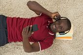 picture of angle  - High Angle View Of African Man Listening Music Or Audiobook - JPG