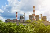 image of thermal  - Thermal power plant with chimneys in the natural environment and flourishing woods in foreground - JPG