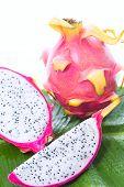 pic of dragon fruit  - Dragon fruit on banana leaf against white background - JPG