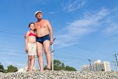 pic of post-teen  - Grandfather with his granddaughter on the railway embankment - JPG