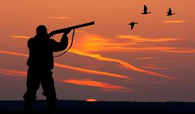 foto of nightfall  - Silhouette of men on the hunting on sunset - JPG