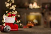 Christmas Background With Christmas Tree On Wooden Table. Red, Golden And Silver Ornaments poster