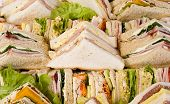 stock photo of catering service  - Close up shots of assorted sandwich triangles on a catering party platter - JPG
