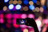 People Taking Photographs With Touch Smart Phone During A Music Entertainment Public Concert poster