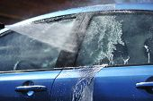 image of car wash  - Blue car washing on open air - JPG