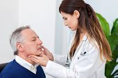 Постер, плакат: Doctor checking the lymph nodes size of her patient