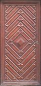 Wooden Door With Diamond And Rivets. Red-brown Color poster