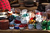Counter With Cups And Plates On The Street Market. Market Of Ceramics. Plates On The Counter In The  poster