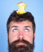 Man Handsome Hipster Long Beard Almost Eaten Apple Stump On Head As Target. Live Target Concept. Wei poster