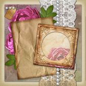 stock photo of pink rose  - Vintage paper frame on vintage background with roses - JPG