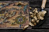 Treasure Map And Shovel Full Of Gold Nuggets Ore On Wooden Table. Treasure Hunter Or Gold Miner Conc poster