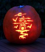 foto of puke  - a carved halloween pumpkin glows in the dark - JPG