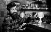 Guy Spend Leisure In Bar, Defocused Background. Man With Cheerful Grimace Face Sit Alone In Bar Or P poster