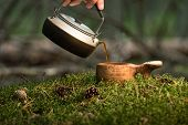 Tea Ceremony At The Taiga. Mini Kettle And Wooden Bowl On A Moss poster