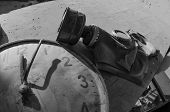 Постер, плакат: Gas Mask And Old Clock In Jupiter Factory In Abandoned Pripyat City In Northern Ukraine Near The Bo