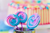 Lollipops Spiral Forms Candy On Pink Background. Funny Concept. Meringue Candy On Paper Stick. Festi poster
