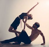 Enjoy Dancing Together. Muscular Man And Cute Woman Perform Modern Dance. Young Woman And Man Dance  poster