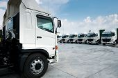 New Truck Fleet Is Parking At Yard With Bewutiful Sky. poster