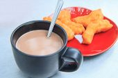 Hot Coco With Deep-fried Doughstick On Disk poster
