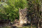 Ancient Stone Ruin In Angkor Wat Temple. Carved Stone Wall In Green Forest. Khmer Heritage Temple Ru poster