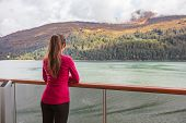 Woman tourist on scenic Alaska cruise in Glacier bay sailing in inside passage. USA vacation travel. poster
