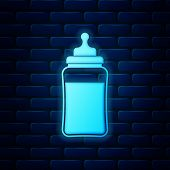 Glowing Neon Baby Bottle Icon Isolated On Brick Wall Background. Feeding Bottle Icon. Milk Bottle Si poster