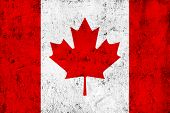 stock photo of frazzled  - Grunge Dirty and Weathered Canadian Flag Old Metal Textured - JPG