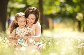 picture of cuddling  - Mother and daughter in the park - JPG