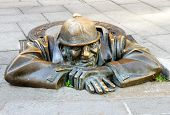stock photo of metal sculpture  - Bronze sculpture Man at work alias Cumil Bratislava Slovakia - JPG