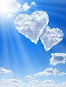 picture of ero  - Hearts in clouds against a blue clean sky - JPG
