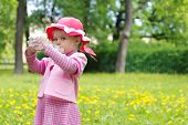 Cute Little Girl Drinking Water In Park