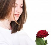 Beautiful Girl Looking At Rose - Focus On Eyes poster