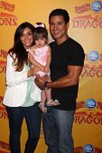LOS ANGELES - JUL 12:  Courtney Mazza, Mario Lopez and their daughter arrives at 'Dragons' presented