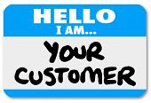 A blue nametag sticker with words Hello I Am Your Customer to represent networking, customer service
