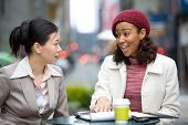 picture of business meetings  - Two business women having a casual meeting or discussion in the city - JPG