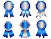 image of rosettes  - Collection of different shaped blank award ribbon rosettes in blue and silver isolated on white - JPG