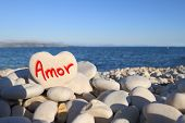 �?�¢??Amor�?�¢?�?� written on heart shaped stone on the beach