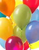 pic of helium  - Colorful helium balloons abstract holiday party background - JPG