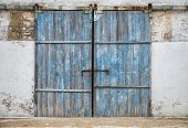 wall of ancient wooden barn with door