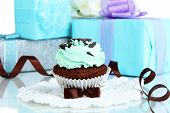 stock photo of sugarpaste  - Tasty cupcake with gifts close up - JPG