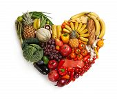 picture of tropical food  - studio photography of heart made from different fruits and vegetables  - JPG